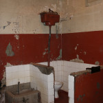 The cell confinement of the prisoners lead to use of this exposed toilet by all the inmates.